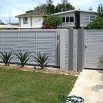 Aluminum fence at front of house with gate
