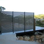 Patio area enclosed with aluminium fence and wire balustrade